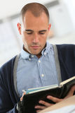 Young businessman writing appointments in agenda royalty free stock photography