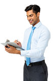 Young Businessman Writing On Clipboard Stock Photography