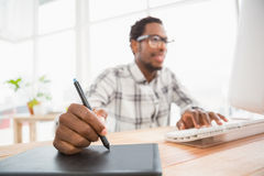 Young businessman writing on the graphic tablet Stock Photos