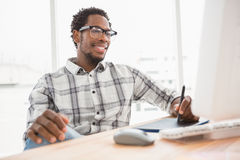 Young businessman writing on the graphic tablet Royalty Free Stock Image