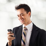 Young businessman writing message Royalty Free Stock Photos