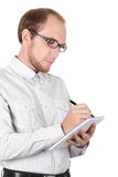 Young businessman writing in notebook Royalty Free Stock Photo