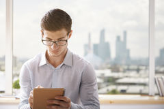 Young businessman writing in office Stock Images
