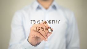 Trustworthy Partner ,Writing on Transparent Screen royalty free stock image
