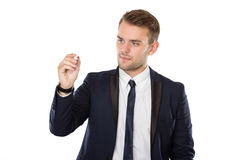 Young businessman writing on virtual screen Royalty Free Stock Images