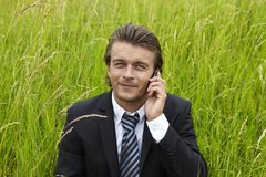 Young businessmann is on the phone Royalty Free Stock Image