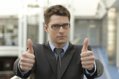 Young businessmanoffice smile thumb u Royalty Free Stock Images