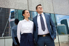 Young businessmen on the background of office buildings Stock Photo