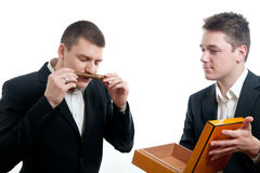 Young businessmen cigar Royalty Free Stock Image