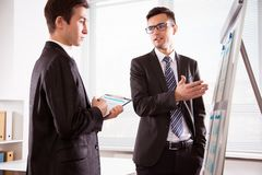 Young businessmen discussing a new project. At modern office Royalty Free Stock Photos