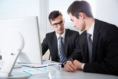Young businessmen discussing a new project. At modern office Royalty Free Stock Image