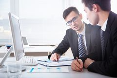 Young businessmen discussing a project. Young businessmen discussing new project at meeting Stock Images