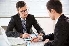 Young businessmen discussing a project Stock Photos