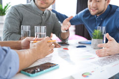 Young businessmen drinking water and discussing new project, business teamwork concept Stock Photo