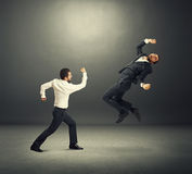 Young businessmen in fight Stock Photos