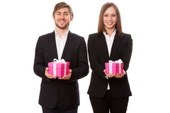 Young businessmen holding gift boxes Stock Photo