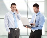 Young businessmen in office lobby Royalty Free Stock Image