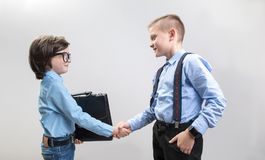 Young businessmen striking advantageous bargain stock photos