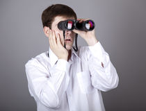 Young businessmen in t-shirt with black binocular Stock Image
