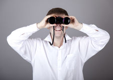 Young businessmen in t-shirt with black binocular Royalty Free Stock Image