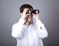 Young businessmen in t-shirt with black binocular Stock Photo