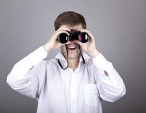 Young businessmen in t-shirt with black binocular Stock Photos