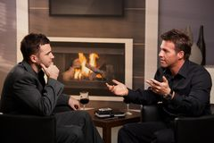 Young businessmen talking in bar stock photography
