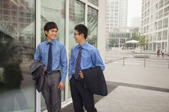 Young businessmen walking outside of the office Royalty Free Stock Image