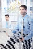 Young businessmen working in bright office Stock Photos