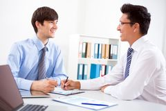 Young businessmen. Discussing a new project at modern office Royalty Free Stock Photography