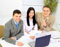 Young businesspeople discuss Royalty Free Stock Images