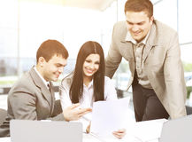 Young businesspeople discuss the new project office. Royalty Free Stock Photos