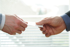 Young businesspeople exchanging Visiting Card In Office Royalty Free Stock Photos