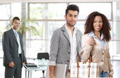 Young businesspeople leaving office Royalty Free Stock Photos