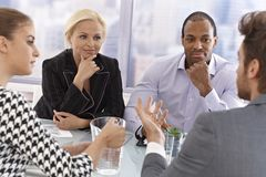 Young businesspeople at a meeting. Young businesspeople sitting at a meeting having discussion Stock Photography