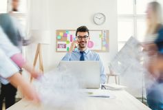 Young businesspeople in a modern office, having meeting. Motion blur. royalty free stock photo