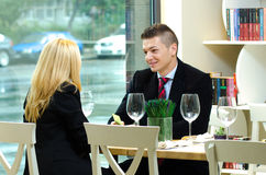 Young businesspeople in a restaurant having a  meeting Stock Photography