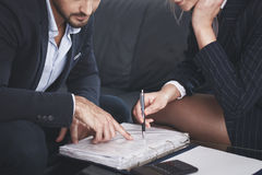 Young businesspeople reviewing the contract. In office stock photo