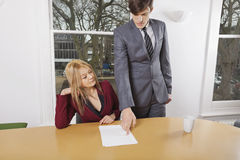 Young businesspeople reviewing documents at conference table Stock Photography