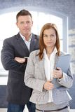 Young businesspeople standing in office Royalty Free Stock Photos
