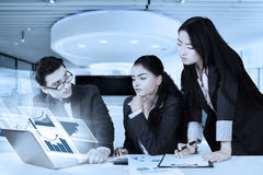 Young businesspeople and virtual chart Royalty Free Stock Image