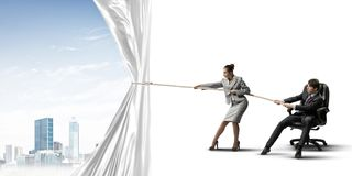 Young businesspeople working in collaboration and pulling white advertisement banner Stock Photography