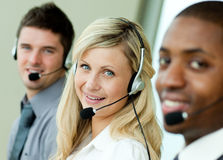 Young businesspeople working with headsets stock photos