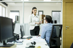 Young businesspeople working in modern office Royalty Free Stock Photos