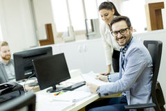 Young businesspeople working in modern office Royalty Free Stock Image