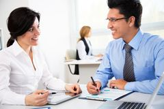Young businesspeople working with tablet. In office Royalty Free Stock Image