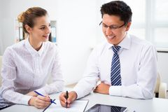 Young businesspeople working with tablet. In office Stock Photo