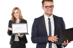 Young businessperson holding laptop Stock Images