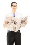 Young businessperson holding a newspaper and looking at camera Stock Photos