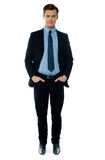 Young businessperson posing with hands in pocket Stock Photo